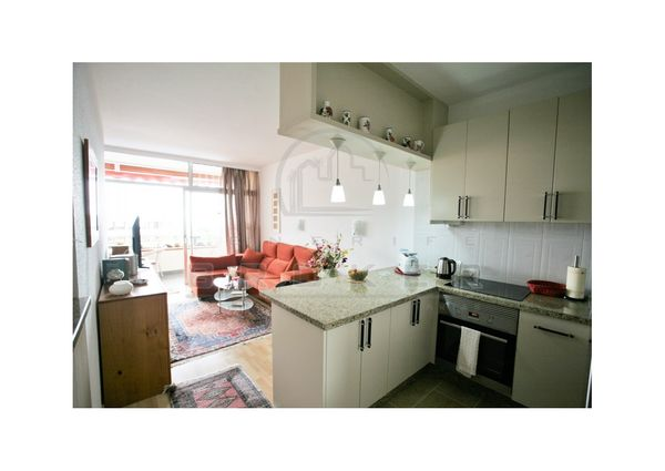 Elegant furnished apartment in complex with swimming pool and tennis court.